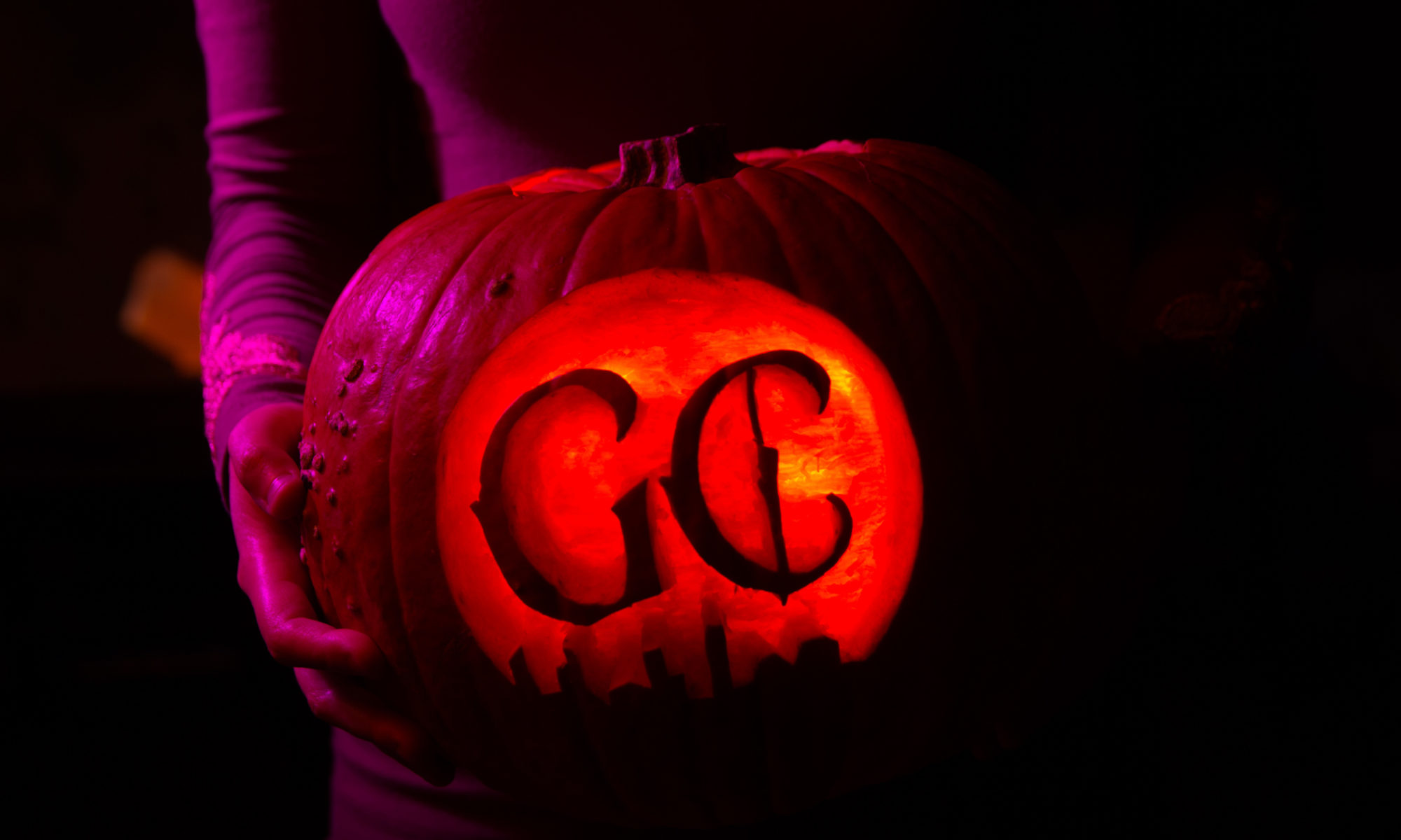 Pumpkin with Ghost City Logo